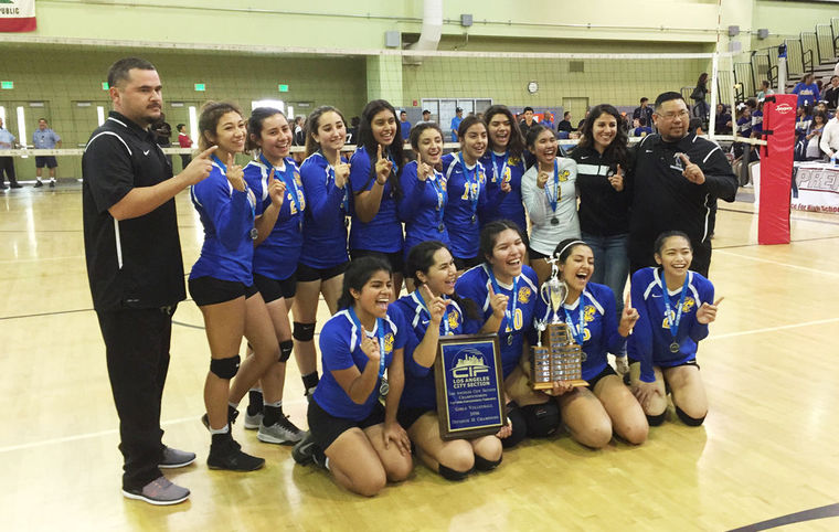 Picturen of Girls Volleyball team and coaches winning Championship